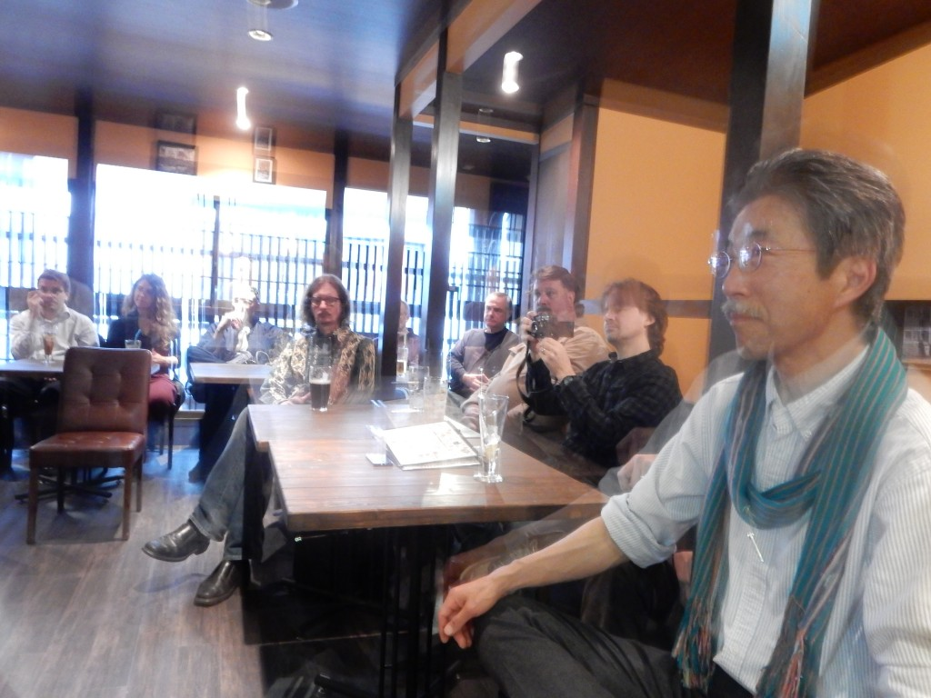 Members of the audience at Amy Chavez's speech. Terry Futaba, the earth pilgrim, in the foreground, with Michael Lambe of Deep Kyoto behind him taking pictures.