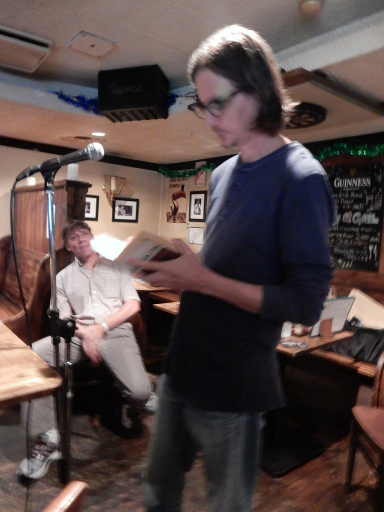 Mark Richardson reads as Mark Scott looks on